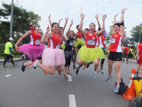 Jumping w_group on road in tutus