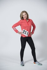 Kathrine Switzer poses with a replica of her first Boston Marathon bib number 261, Friday 24 February 2017 in Wellington, New Zealand. Credit: Hagen Hopkins.